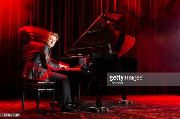 man playing grand piano - red jacket stock pictures, royalty-free photos & images