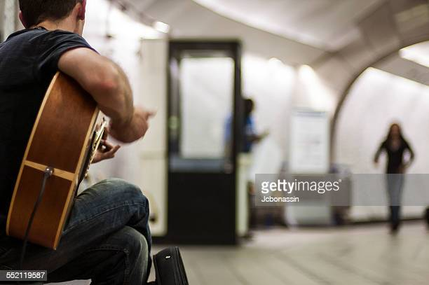 man playing guitar at the london underground - jcbonassin stock-fotos und bilder