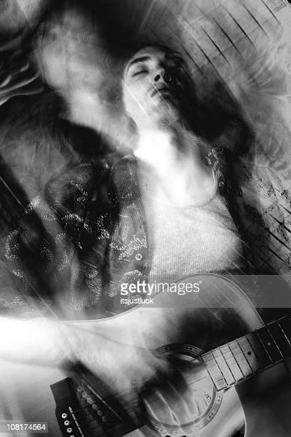 man playing guitar, distortion and blur - psychedelic music stock photos and pictures