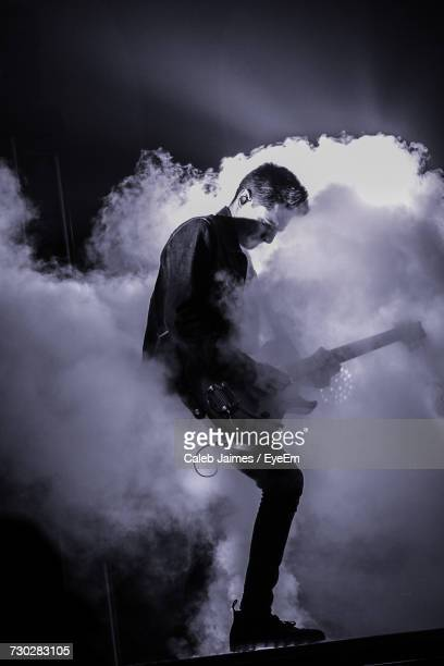 Man Playing Guitar In Concert At Night