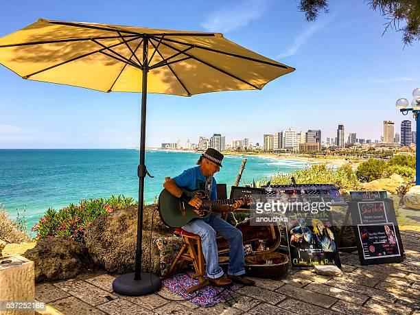Man playing guitar in Old Jaffa, Tel Aviv