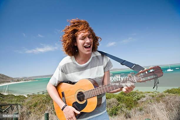 Man playing guitar outdoors