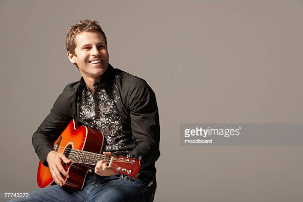 man playing guitar - country and western music stock pictures, royalty-free photos & images