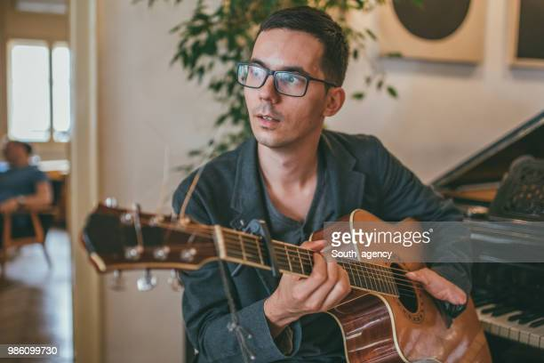 man playing guitar - amputee stock pictures, royalty-free photos & images