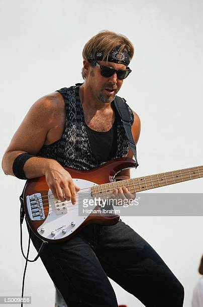 man playing guitar - modern rock stock pictures, royalty-free photos & images