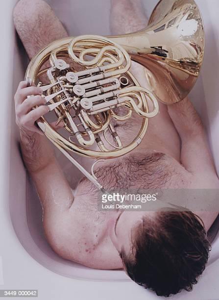 Man Playing Horn in Bath