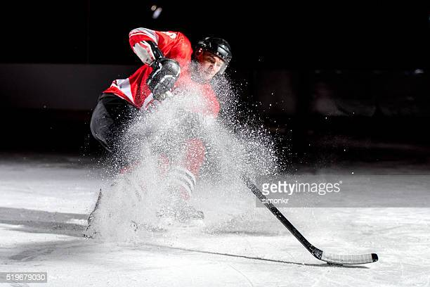man playing ice hockey - hockey stock pictures, royalty-free photos & images