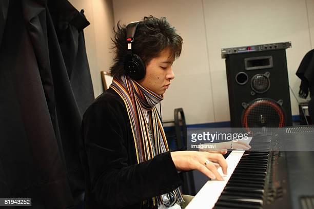 man playing instrument in the recording studio - keyboard player stock photos and pictures