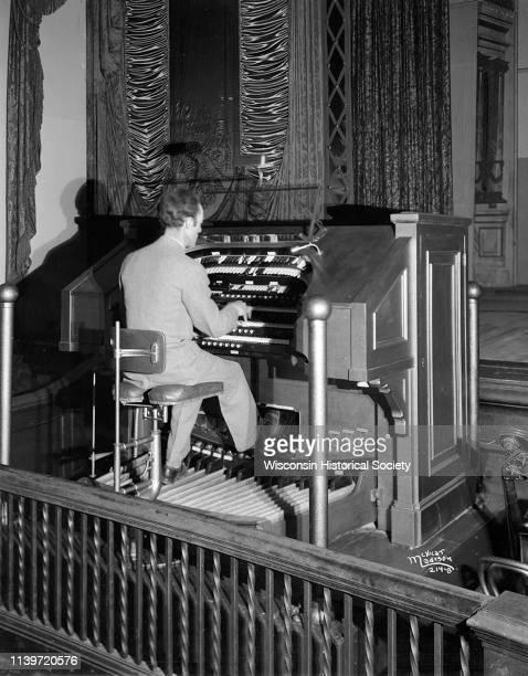Man playing Kimball organ at the Orpheum Theatre, Madison, Wisconsin, April 5, 1927.