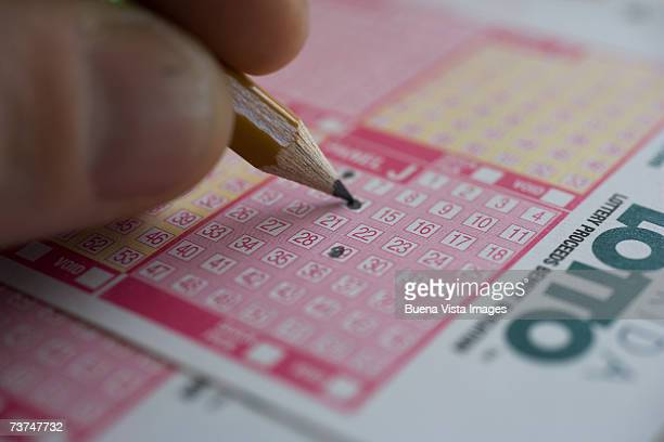 man playing lotto - lotterytickets stock pictures, royalty-free photos & images