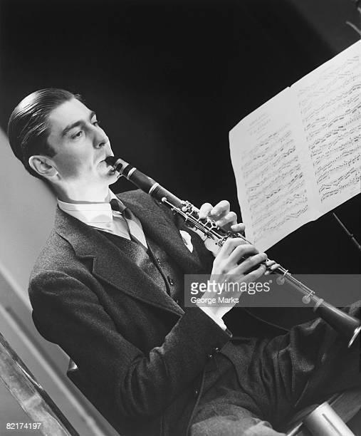 man playing oboe, (b&w) - oboe stock-fotos und bilder