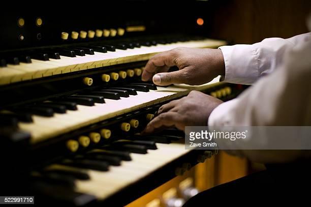 man playing organ - church organ stock pictures, royalty-free photos & images