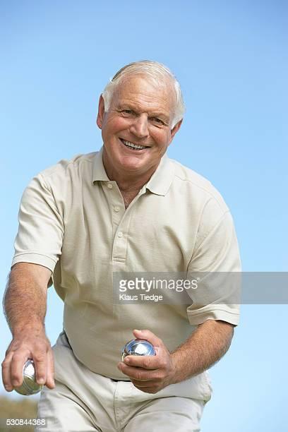 Man playing petanque