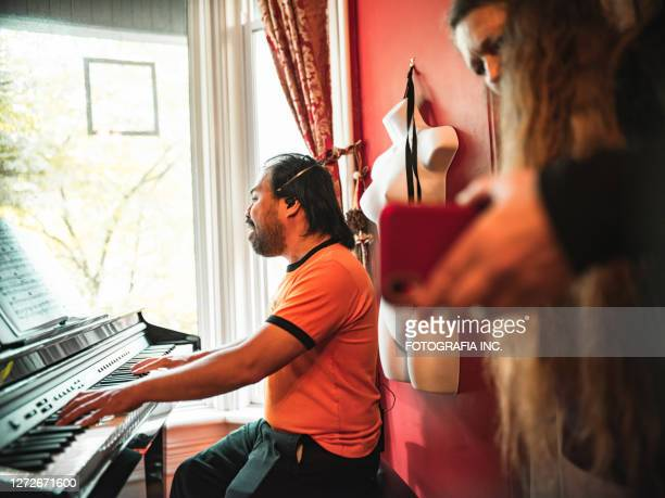man playing piano and singing - hamiltonmusical stock pictures, royalty-free photos & images