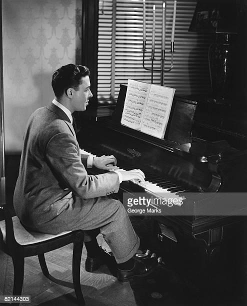 Man playing piano, (B&W)