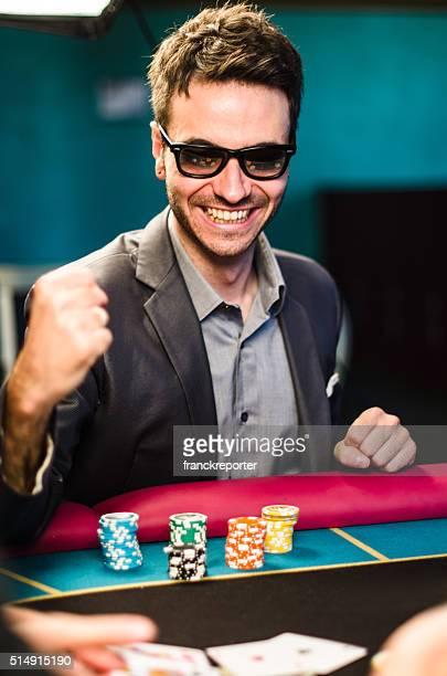 Man playing poker at casino