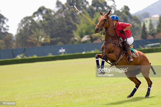 Man playing polo