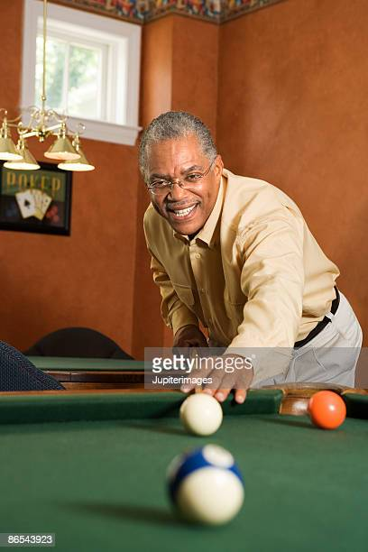 man playing pool - old men playing pool stock pictures, royalty-free photos & images