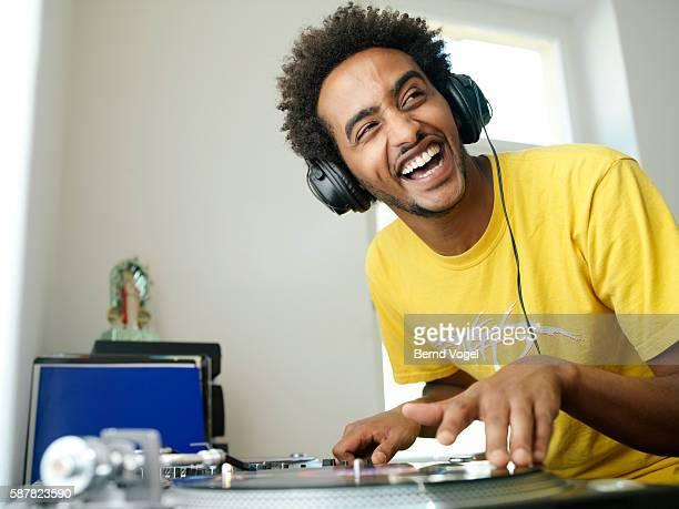 Man playing record album