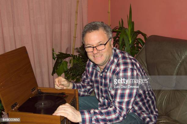 Man playing record album