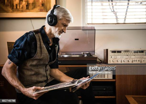 Man (60yrs) playing records at home