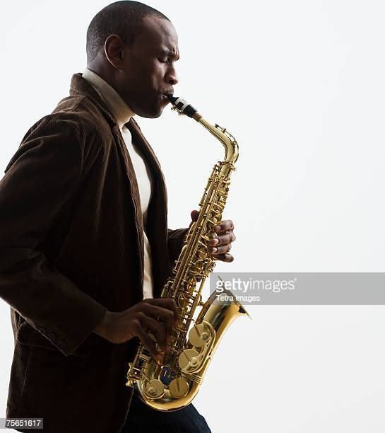 man playing saxophone - jazz stock pictures, royalty-free photos & images