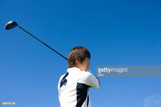 Man playing shot under the blue sky, blue background, Saipan, USA