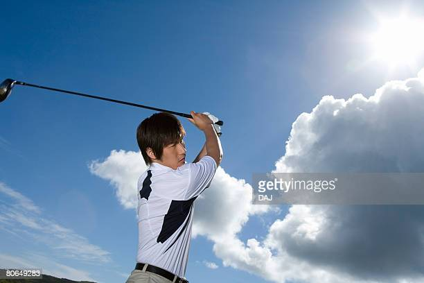 Man playing shot under the blue sky, lens flare, Saipan, USA