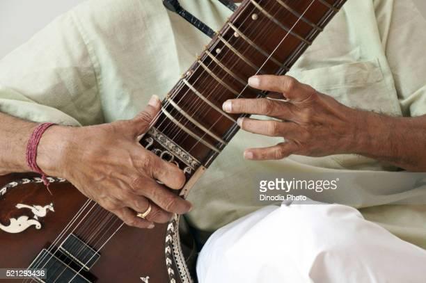 Man Playing Sitar at Mumbai, Maharashtra, India, Asia