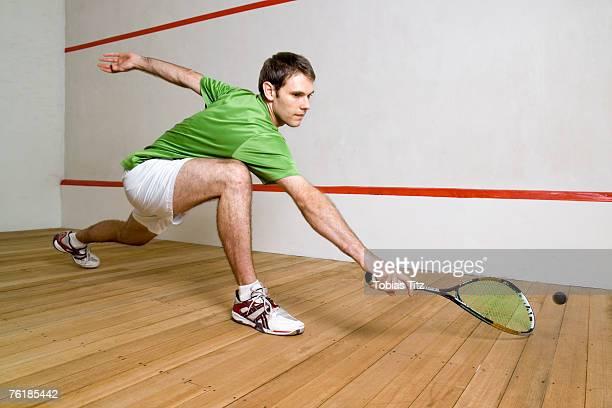 A man playing squash