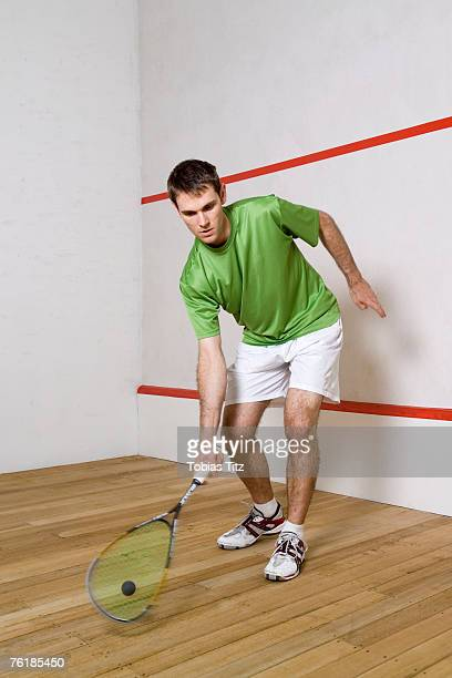 A man playing squash