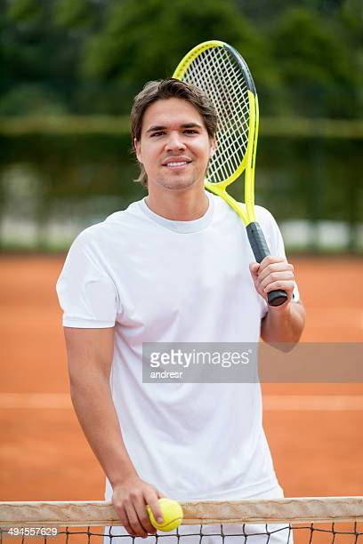 man playing tennis - racquet sport stock photos and pictures