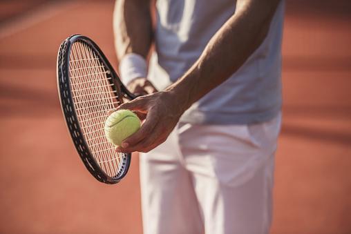 Man playing tennis 869081776