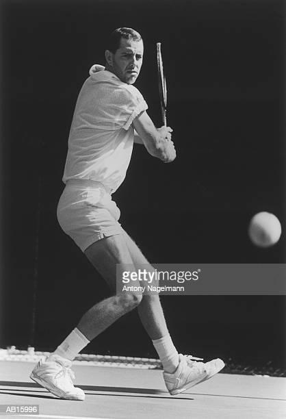Man playing tennis (B&W)