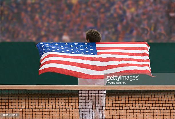 Man playing tennis with US flag
