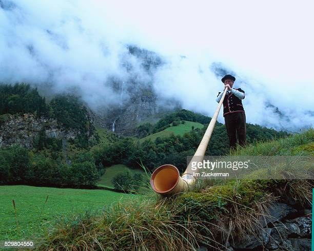 Man Playing the Alpenhorn
