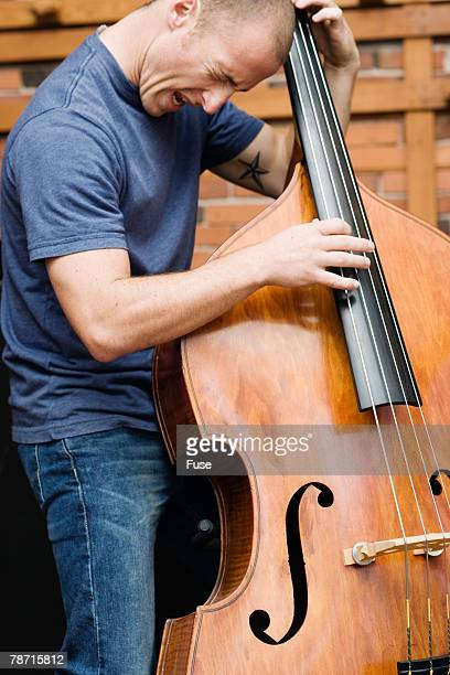 Man Playing the Double Bass