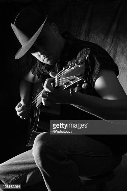 man playing the guitar - stars and strings stock photos and pictures