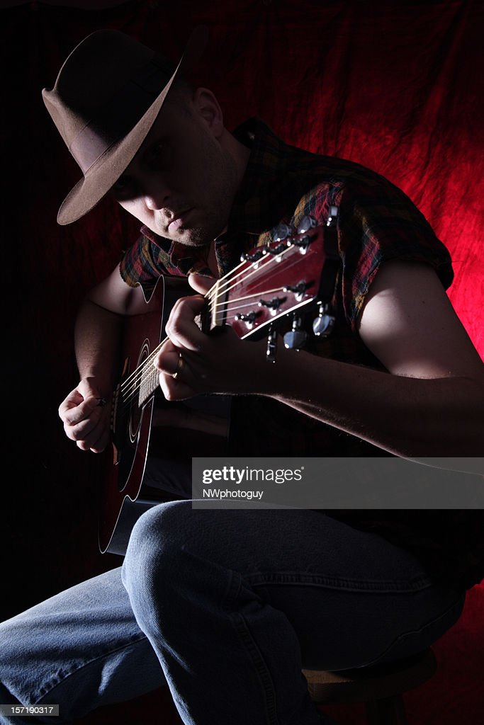 Man playing the Guitar : Stock Photo