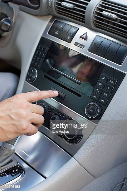 Man playing the music in car