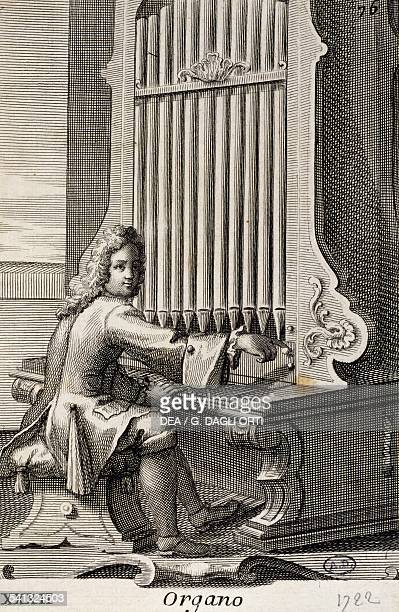 Man playing the organ by Filippo Bonanni from Musical cabinet full of sounding instruments shown and explained with 150 engravings collection of...