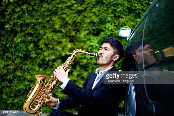man playing the saxophone - saxophone stock pictures, royalty-free photos & images