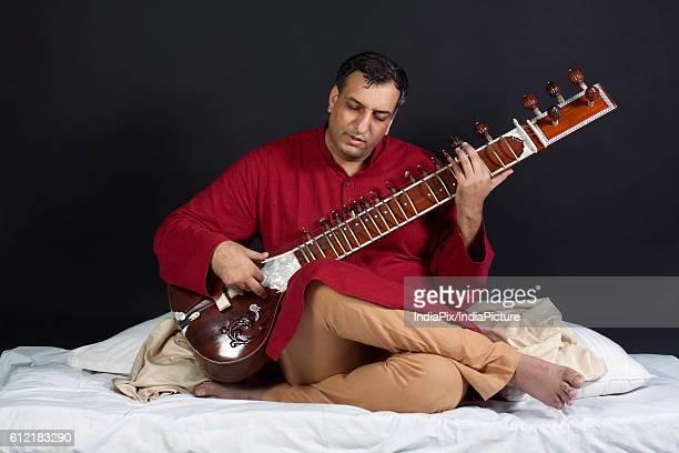 Man playing the sitar