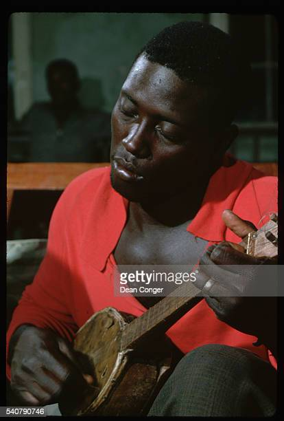 Man Playing the Ukulele