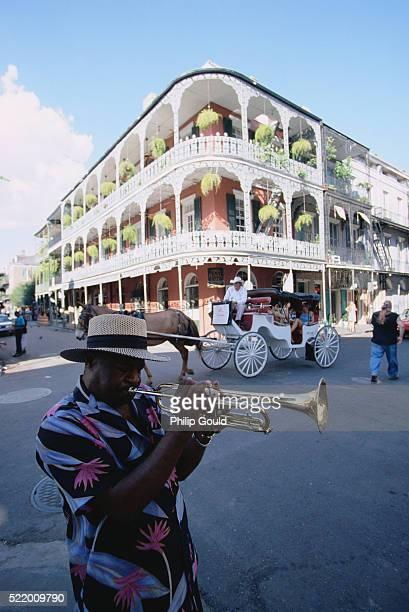 Man Playing Trumpet in Street
