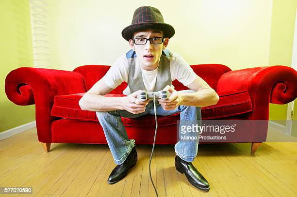 Man Playing Video Game on Couch