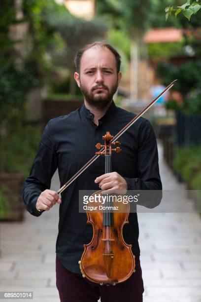 Man playing violin outdoors