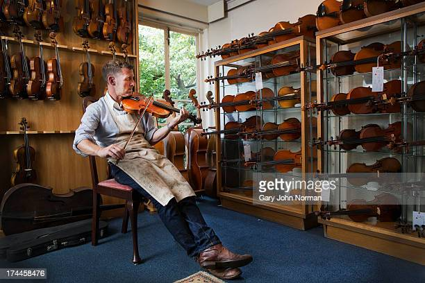 man playing violin - musician stock pictures, royalty-free photos & images