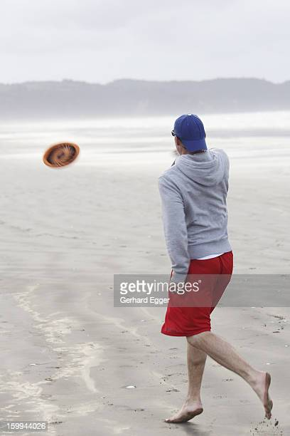 Man playing with a frisbee on beach