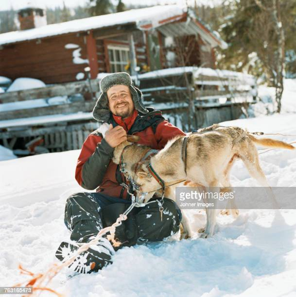 A man playing with dogs.